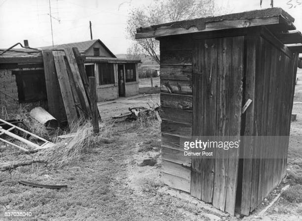 This outhouse provided the toilet facilities for a woman and her three children who live in that house in the background They are about to prove into...