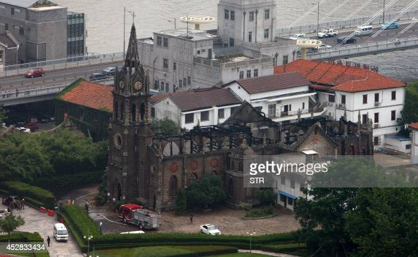 This overhead view shows a firetruck beside the Ningbo cathedral as firefighters put out a fire at the structure in Ningbo in eastern China's...