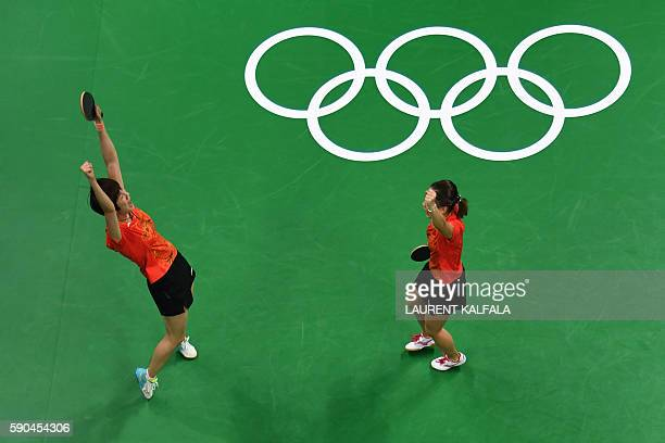 This overview shows China's Liu Shiwen and China's Ding Ning celebrating winning the women's team gold medal final table tennis match against Germany...