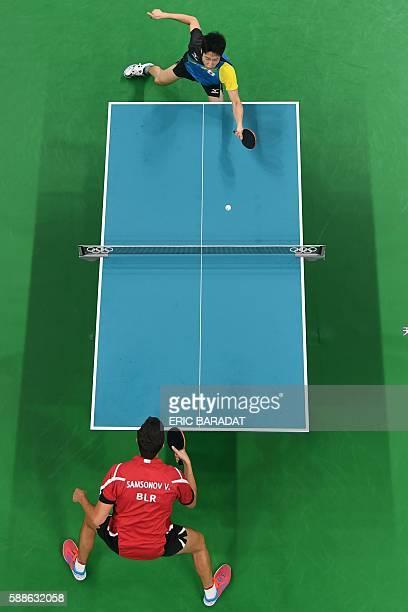 This overview shows Japan's Jun Mizutani hitting a shot against Belarus' Vladimir Samsonov in their men's singles bronze medal table tennis match at...