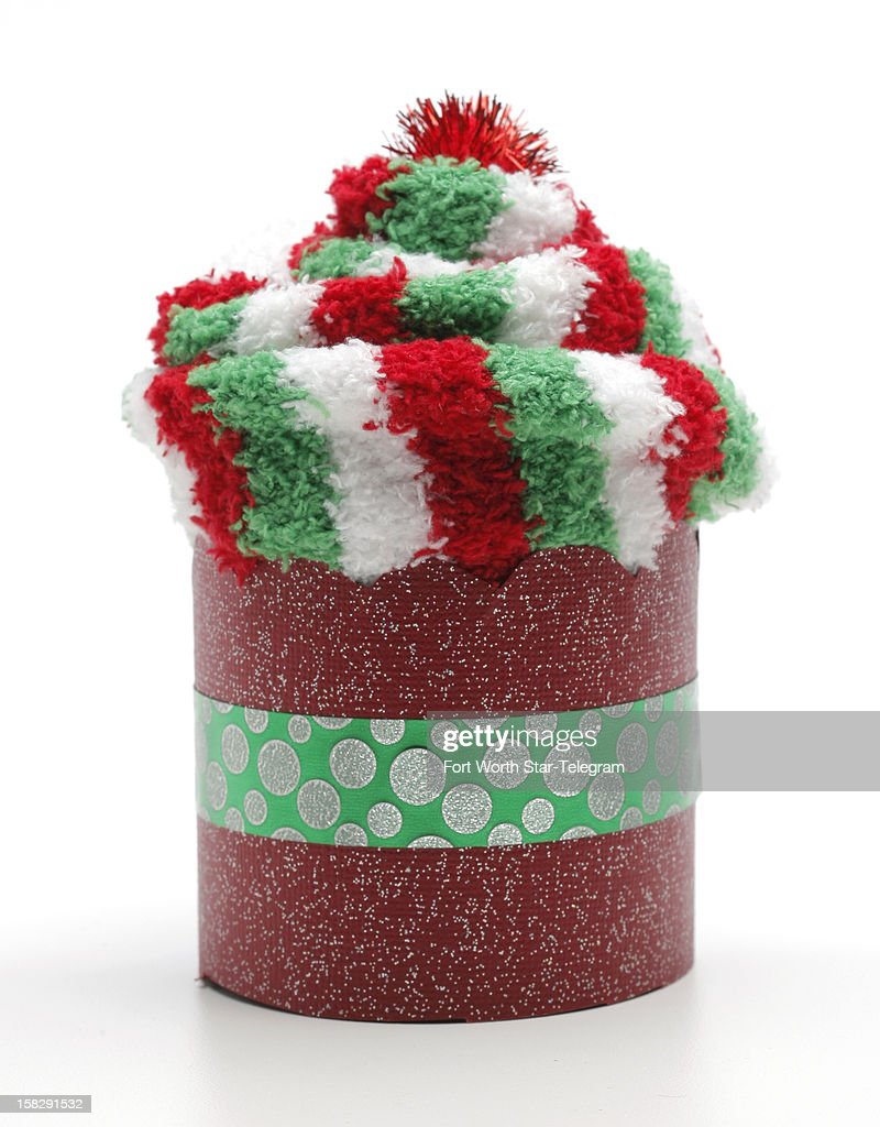 This pair of festive holiday socks packaged in a fun way will make a tiny partygoer's day.
