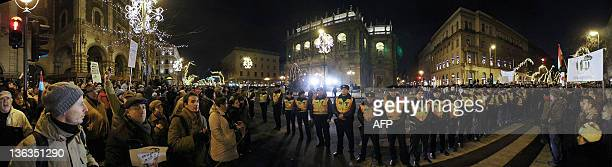 This panoramic picturetaken late on January 2 2012 shows Hungarian police standing surrounded at the State Opera House of Budapest by tens of...