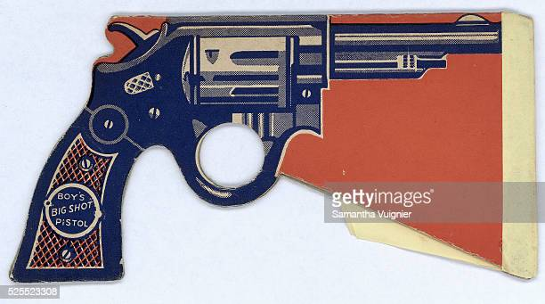 This paper pistol is designed to make a popping sound when swung rapidly downward