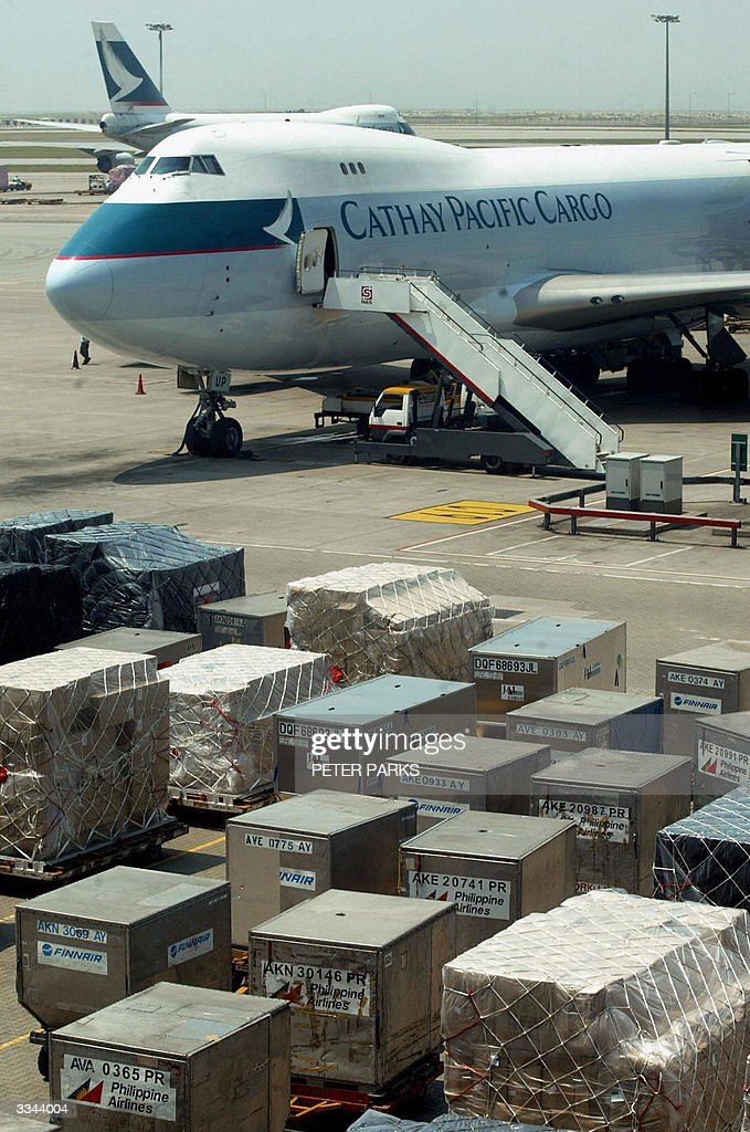 This photo dated 20 October 2002 shows a Cathay Pacific cargo plane being loaded at Hong Kong's Chek Lap Kok airport Hong Kongbased airline Cathay...