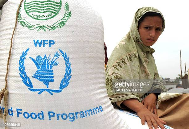 This photo dated May 2 2009 shows a displaced Pakistani woman from Buner sitting on bags of food after receiving them from a United Nationd World...