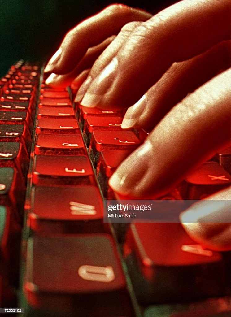 This photo illustration depicts a person typing May 4 2001 in Denver CO The June 12 2001 issue of 'Neurology' magazine reports that typing does not...