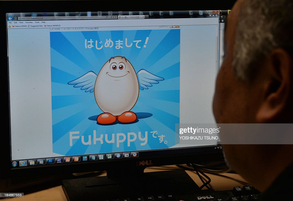 This photo illustration shows a man looking at a computer screen displaying the mascot 'Fukuppy' of Japan's refrigerator maker Fukushima Industries on the company's homepage in Tokyo on October 15, 2013. Japan's Fukushima Industries said on October 15 it was rethinking its 'Fukuppy' mascot, after the Internet erupted in sniggers over a name that recalls the catalogue of mishandling at the Fukushima nuclear plant. AFP PHOTO / Yoshikazu TSUNO