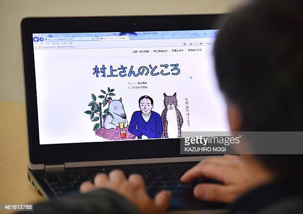 This photo illustration shows a man looking at newly opened website 'Murakamisan no tokoro' or 'Mr Murakami's place' illustrated by artist Masaru...