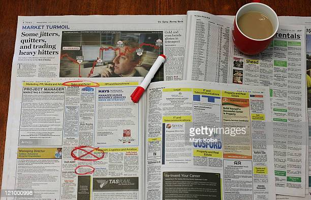 This photo illustration shows a newspaper employment section over a share market article on August 13 2011 in Sydney Australia News the unemployment...