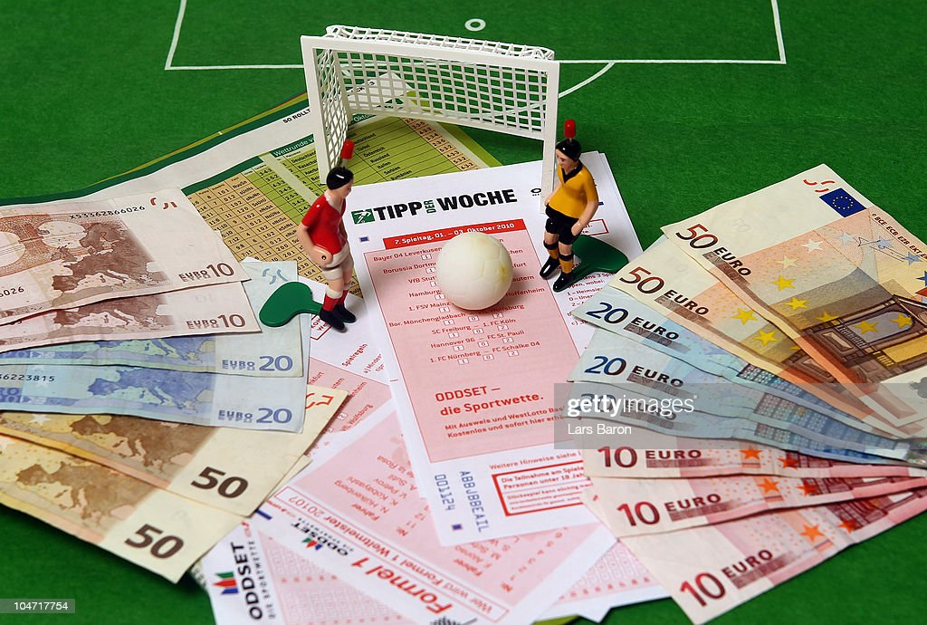 This photo illustration shows betting slips together with Euro bank notes and a table soccer game on October 2, 2010 in Dinslaken, Germany. The first two suspects in Germany in Europe's biggest football betting scandal ever will face charges in a trial to begin in Bochum on October 6 over attempting to rig at least 24 matches in Europe, including matches in Germany's second division 2. Bundesliga league. In all prosecutors are investigating 250 suspects for attempting to influence the outcome of some 270 matches across Europe. Prosecutor claim the betting ring made profits of at least EUR 7.5 million on manipulated games.