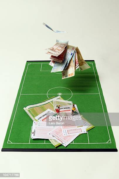 This photo illustration shows betting slips together with Euro bank notes and a table soccer game on October 2 2010 in Dinslaken Germany The first...