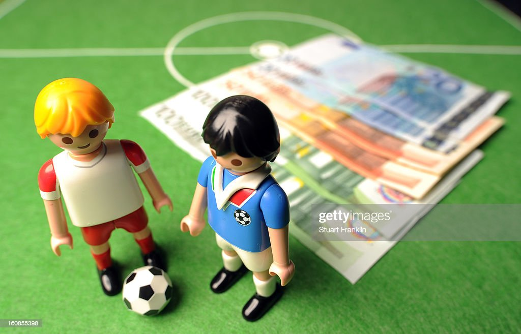 This photo illustration shows Euro bank notes and a table soccer game on February 6, 2013 in Hamburg, Germany. Europol have uncovered evidence that hundreds of football matches were subject to corruption leaving more than 400 officials and players under suspicion of involvement.