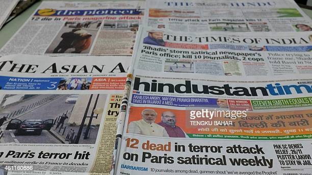 This photo illustration shows front page newspaper reports in New Delhi on January 8 2015 of the attack by gunmen on French satirical weekly Charlie...