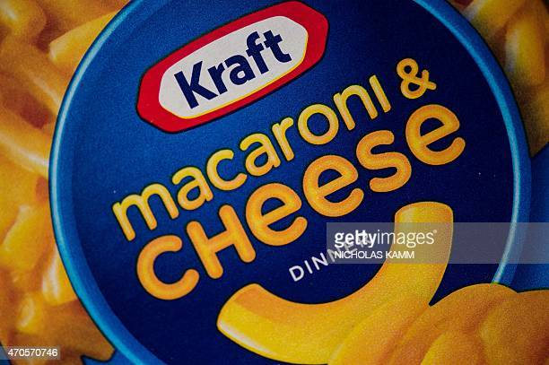 This photo illustration shows packs of Kraft's macaroni and cheese in Washington on April 21 2015 From January next year two kinds of yellow dye will...