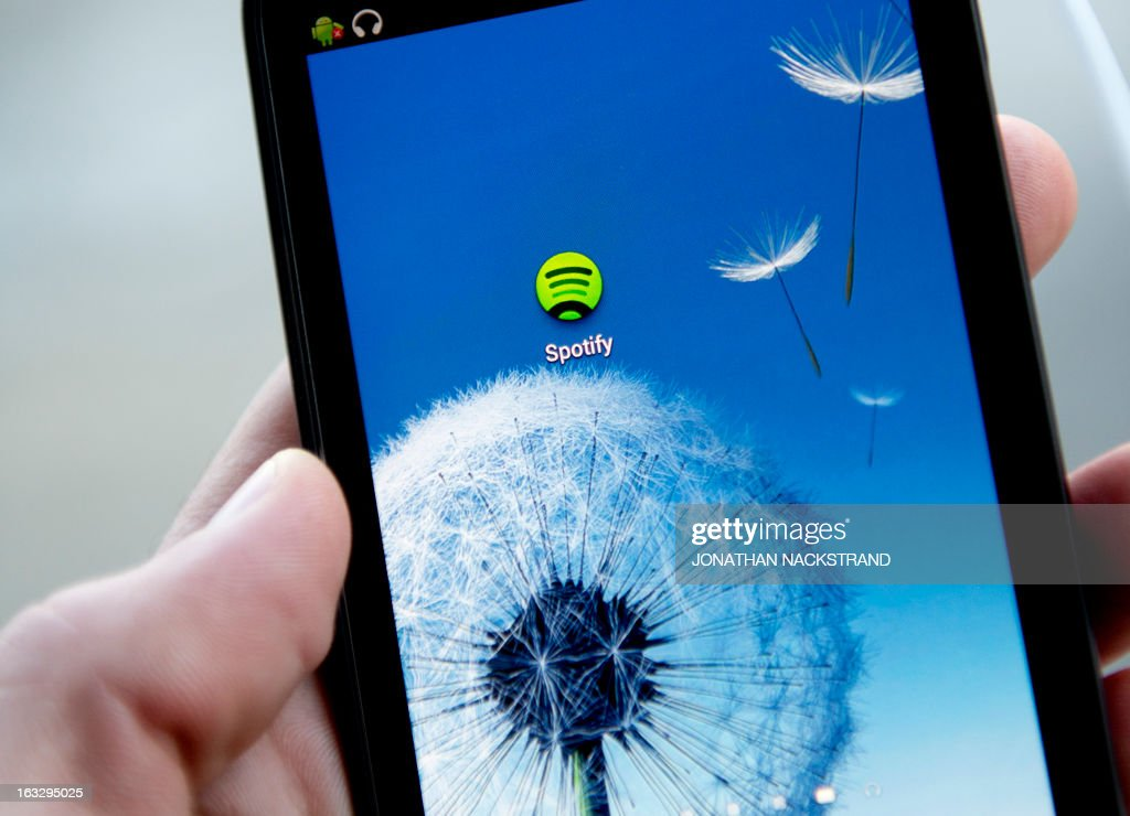 This photo illustration shows the Android application logo of Swedish music streaming service Spotify on March 7, 2013 in Stockholm, Sweden. Sweden is at the forefront of a global recovery in music sales driven by streaming music services such as Spotify.