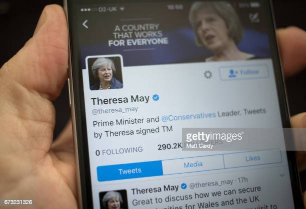 This photo illustration shows the Twitter page for Prime Minister Theresa May on an iPhone on April 26 2017 in Bristol England The use of digital...