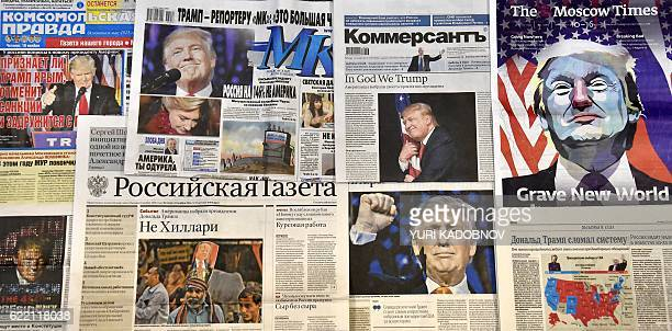 This photo illustration taken in Moscow on November 10 2016 shows front pages of Russian newspapers reporting on the victory of Donald Trump in the...