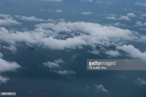 This photo is taken on June 8 taken from a plane shows a small island in the Andaman sea near Dawei northern part of Myanmar Myanmar navy ships...