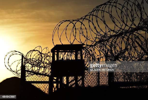 This photo made during an escorted visit and reviewed by the US military shows the razor wiretopped fence and a watch tower at the abandoned 'Camp...