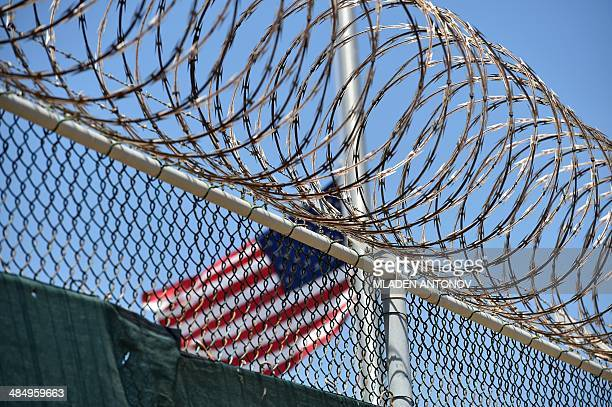 This photo made during an escorted visit and reviewed by the US military shows the razor wiretopped fence of 'Camp 6' detention facility at the US...