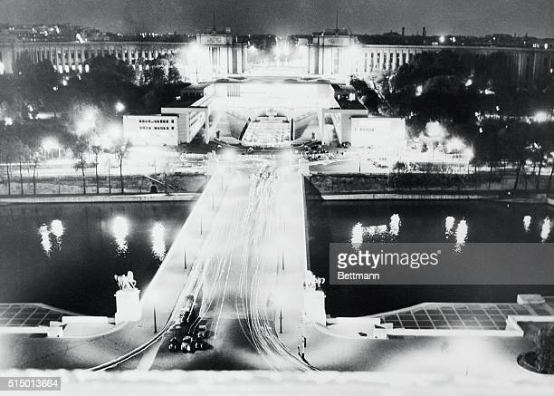 This photo made from the famed Eiffel Tower shows the Palace De Chaillot a blaze of light as 'The Big Three' of the Western Powers and Chancellor...