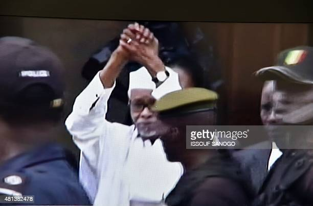 This photo of a television screen taken on July 20 2015 shows pictures of Senegalese tv announcing the trial of former Chadian dictator Hissene Habre...