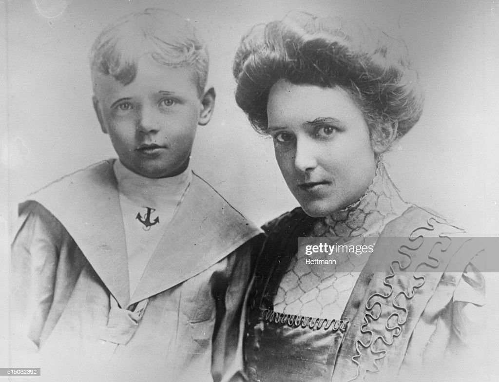 This photo, one of the early ones taken in Minneapolis, Minnesota, shows Captain Charles A. Lindbergh at the age of eight years, with his mother, Mrs. Evangeline Lindbergh.