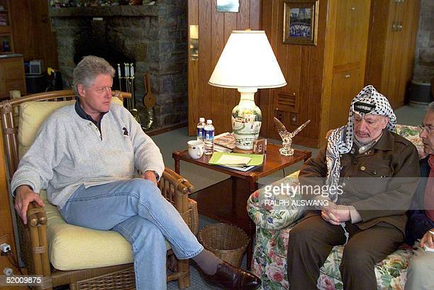 This photo released bby the White House 24 July shows US President Bill Clinton meeting with Palestinian Authority Chairman Yasser Arafat 24 July at...