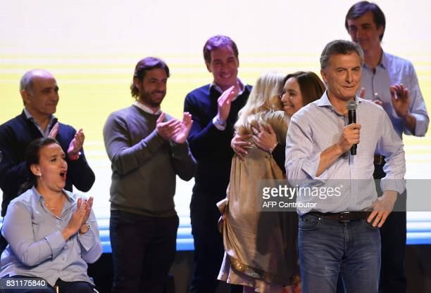 This photo released by Telam shows Argentinian President Mauricio Macri kissing the hand of Argentinian Vicepresident Gabriela Michetti during a...