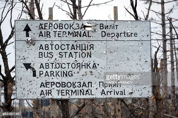 This photo shows a pierced by shrapnel road sign near the destroyed airport in the eastern Ukrainian city of Donetsk on February 26 2015 Ukraine's...