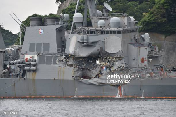 This photo shows damages on the guided missile destroyer USS Fitzgerald at its mother port in Yokosuka southwest of Tokyo on June 18 2017 A number of...