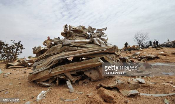 This photo shows debris of the Air Algerie Flight AH 5017 scattered at the crash site in Mali's Gossi region west of Gao on July 26 2014 UN experts...