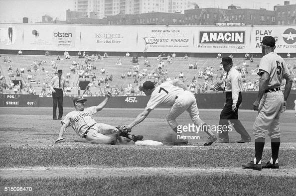 This photo shows Mickey Mantle of the Yankees playing first base with 'tagging' in full action during the game against the Boston Red Sox