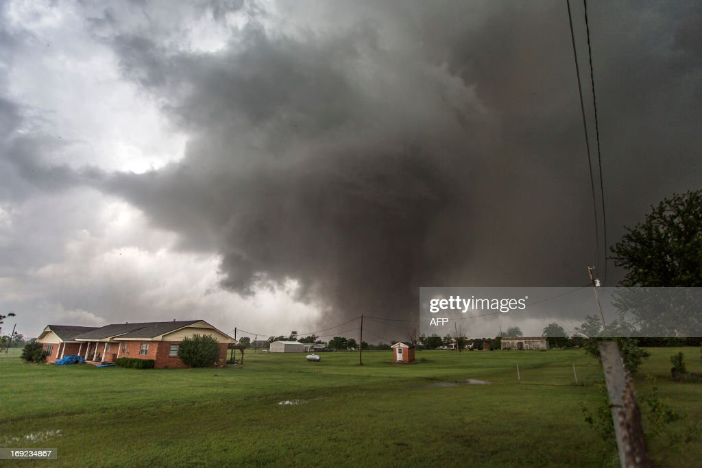 This photo shows the approaching tornado on May 20 2013 in Moore Oklahoma Families returned to a blasted moonscape that had been an American suburb...