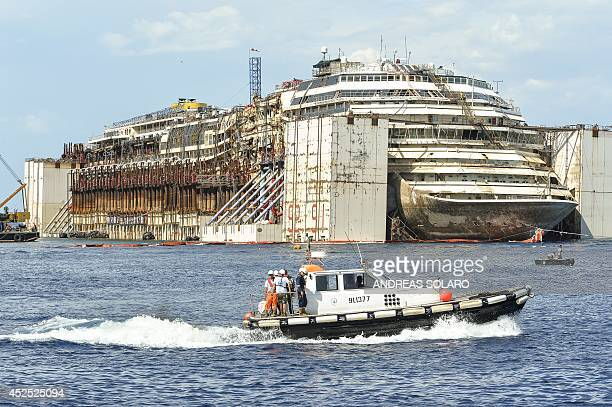 This photo shows the wreck of the Costa Concordia cruise ship in front of the harbour of Isola del Giglio after it was refloated using air tanks...