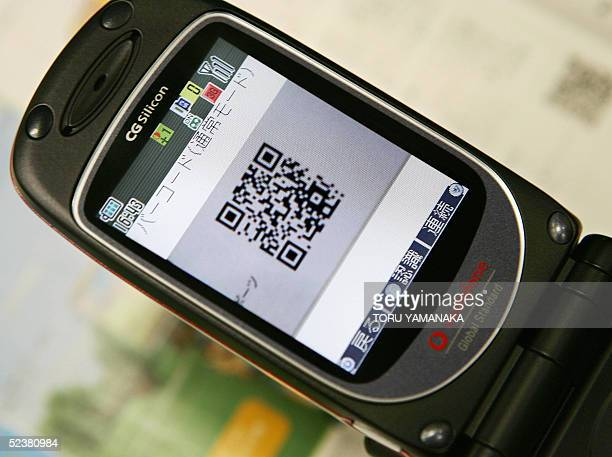 This photo taken 11 March 2005 shows a 'QR Code' being displayed in a cameraequipped mobile phone in Tokyo QR Code allows users to enter text...
