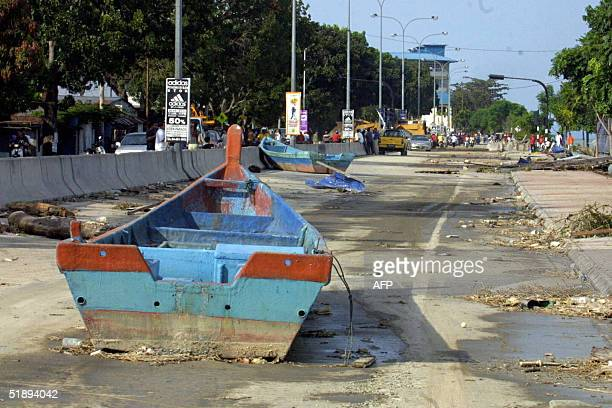 This photo taken 26 December 2004 in Penang northwest Malaysia shows row boats and debris littering the streets following a tsunami or tidal wave...