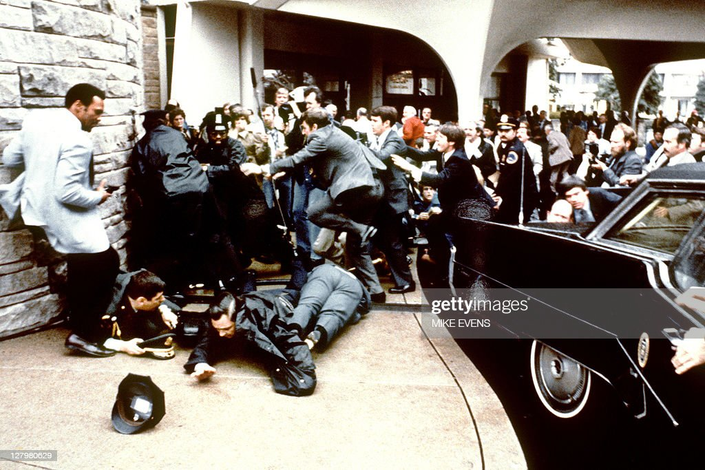 This photo taken by presidential photographer Mike Evens on March 30 1981 shows police and Secret Service agents reacting during the assassination...