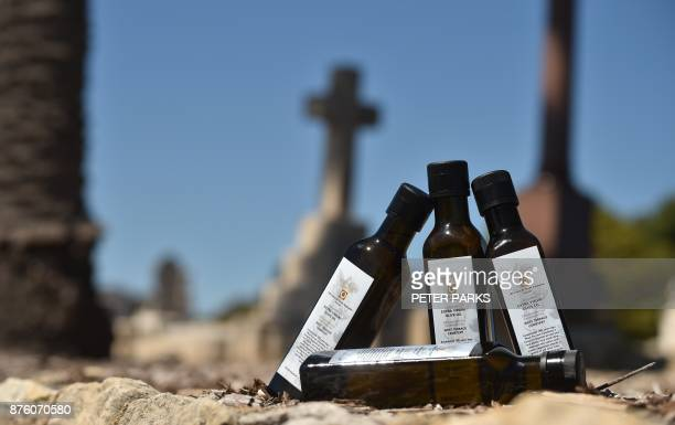This photo taken in a cemetery on September 27 2017 shows the last four bottles of 2017 limitededition olive oil released to mark the 180th...