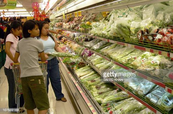 This photo taken in July 2005 shows Thai customers busy in their monthend shopping in Bangkok Thailand's inflation rate hit 56 percent 01 September...