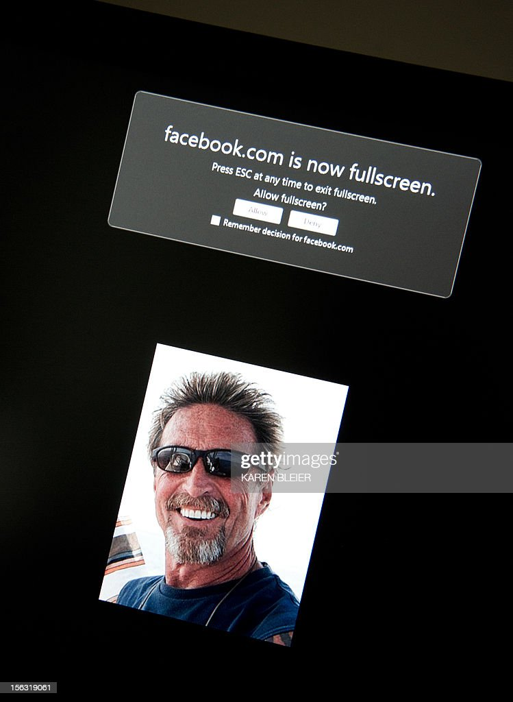 This photo taken November 13, 2012 in Washington, DC shows a facebook page belonging to John McAfee(pictured). McAfee, founder of the eponymous anti-virus company, is on the run for killing another US citizen in a resort town, Belizean police said Monday. Police raided McAfee's mansion on Ambergris Caye, an island off the northeastern coast of Belize, late Sunday to question him about the murder of American Gregory Faull. But McAfee was nowhere to be found, said the head of the country's anti-organized crime brigade, Marco Vidal. Vidal told reporters that McAfee was wanted 'for homicide.'But McAfee told the US magazine Wired that he was in fact hiding on the property at the time, burying himself in the sand with a cardboard box over his head in order to breathe. 'It was extraordinarily uncomfortable,' he said. 'But they will kill me if they find me.' Asked about the shooting of his neighbor, McAfee said he knew 'nothing' other than he had shot. The anti-virus pioneer even said he was worried that Faull's killers had actually been looking for him. AFP PHOTO / Karen BLEIER