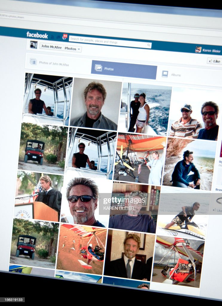 This photo taken November 13, 2012 in Washington, DC shows a facebook page showing photos of John McAfee. McAfee, founder of the eponymous anti-virus company, is on the run for killing another US citizen in a resort town, Belizean police said Monday. Police raided McAfee's mansion on Ambergris Caye, an island off the northeastern coast of Belize, late Sunday to question him about the murder of American Gregory Faull. But McAfee was nowhere to be found, said the head of the country's anti-organized crime brigade, Marco Vidal. Vidal told reporters that McAfee was wanted 'for homicide.'But McAfee told the US magazine Wired that he was in fact hiding on the property at the time, burying himself in the sand with a cardboard box over his head in order to breathe. 'It was extraordinarily uncomfortable,' he said. 'But they will kill me if they find me.' Asked about the shooting of his neighbor, McAfee said he knew 'nothing' other than he had shot. The anti-virus pioneer even said he was worried that Faull's killers had actually been looking for him. AFP PHOTO / Karen BLEIER
