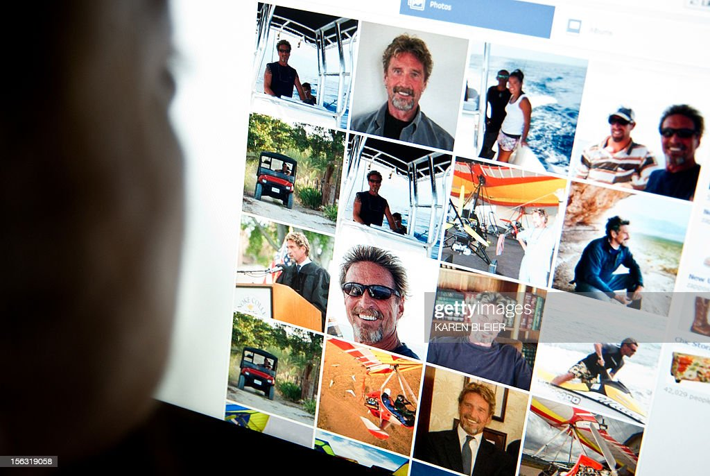 This photo taken November 13, 2012 in Washington, DC shows a woman viewing a facebook page belonging to John McAfee(pictured). McAfee, founder of the eponymous anti-virus company, is on the run for killing another US citizen in a resort town, Belizean police said Monday. Police raided McAfee's mansion on Ambergris Caye, an island off the northeastern coast of Belize, late Sunday to question him about the murder of American Gregory Faull. But McAfee was nowhere to be found, said the head of the country's anti-organized crime brigade, Marco Vidal. Vidal told reporters that McAfee was wanted 'for homicide.'But McAfee told the US magazine Wired that he was in fact hiding on the property at the time, burying himself in the sand with a cardboard box over his head in order to breathe. 'It was extraordinarily uncomfortable,' he said. 'But they will kill me if they find me.' Asked about the shooting of his neighbor, McAfee said he knew 'nothing' other than he had shot. The anti-virus pioneer even said he was worried that Faull's killers had actually been looking for him. AFP PHOTO / Karen BLEIER