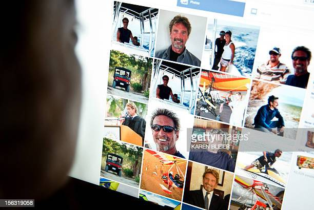 This photo taken November 13 2012 in Washington DC shows a woman viewing a facebook page belonging to John McAfee McAfee founder of the eponymous...