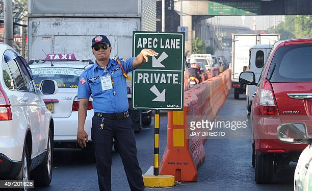 This photo taken November 14 shows a traffic aid directing commuters ahead of the AsiaPacific Economic Cooperation summit in Manila US President...