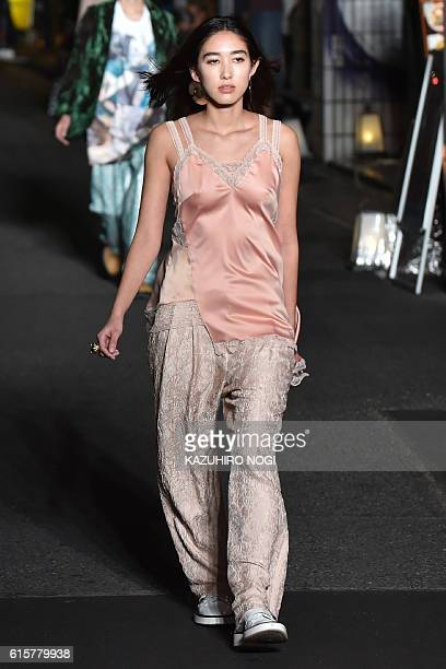 This photo taken October 19 2016 shows a model displaying a creation by designer Christelle Kocher during the KOCHE AW16 and SS17 mix collection show...