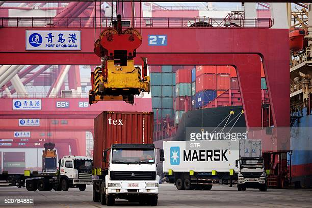 This photo taken on April 12 2016 shows trucks transporting containers at a port in Qingdao east China's Shandong province China's exports surged 115...
