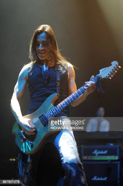 This photo taken on April 12 2017 shows Portuguese guitarist Nuno Bettencourt formerly from the US band Extreme playing with Generation Axe A Night...
