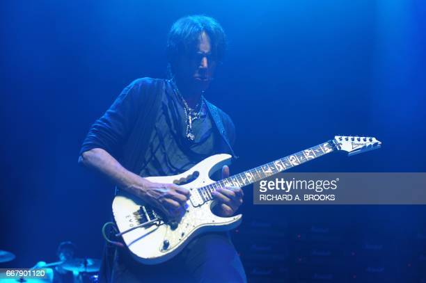This photo taken on April 12 2017 shows US guitarist Steve Vai playing with Generation Axe A Night of Guitars during their Asian tour at Star Hall in...