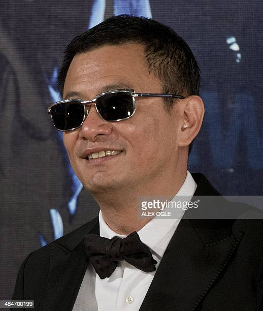 This photo taken on April 13 2014 shows filmmaker Wong Kar Wai arriving at the 33rd Hong Kong Film Awards in Hong Kong The annual awards are the Hong...